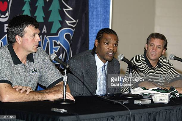Latrell Sprewell of the Minnesota Timberwolves speaks to the media alongside Timberwolves vice president of basketball operations and general manager...