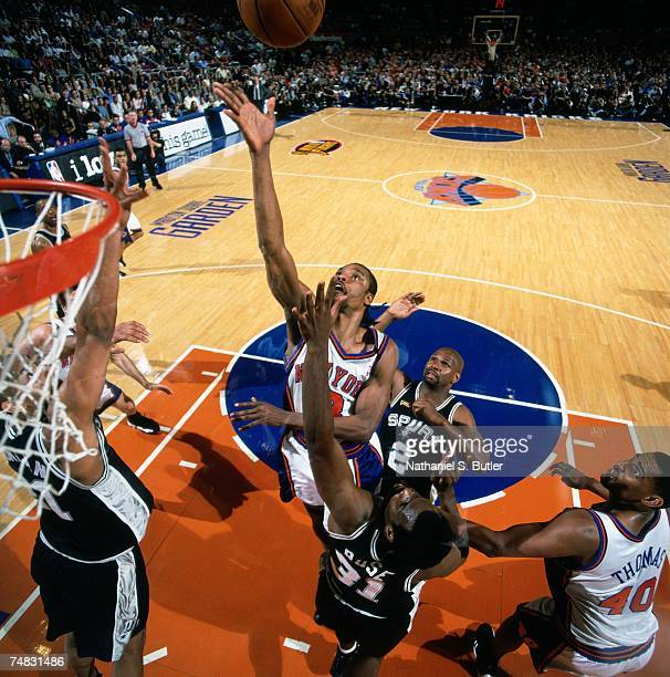 Latrell Sprewell of the New York Knicks battles for the rebound against Malik Rose of the San Antonio Spurs during Game Five of the 1999 NBA Finals...