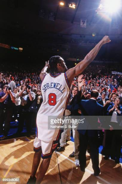 Latrell Sprewell of the New York Knicks celebrates with the crowd after winning the 1999 NBA Eastern Conference Finals against the Indiana Pacers at...