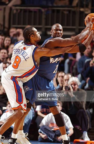 Latrell Sprewell of the New York Knicks defending Michael Jordan of the Washington Wizards during a game at Madison Square Garden in New York New...