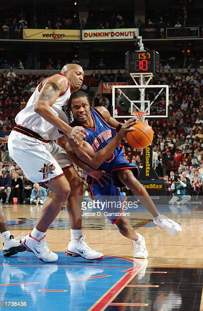 Latrell Sprewell of the New York Knicks drives against Derrick Coleman of the Philadelphia 76ers during the NBA game at First Union Center on January...