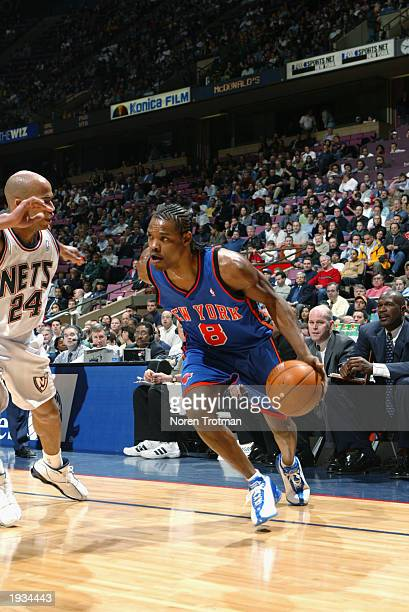 Latrell Sprewell of the New York Knicks drives against Richard Jefferson of the New Jersey Nets during the game at Continental Airlines Arena on...