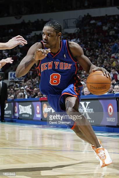 Latrell Sprewell of the New York Knicks drives against the Minnesota Timberwolves during the game at Target Center on March 2 2003 in Minneapolis...