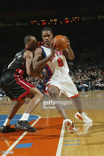 Latrell Sprewell of the New York Knicks drives past Caron Butler of the Miami Heat during the game at Madison Square Garden on January 20 2003 in New...
