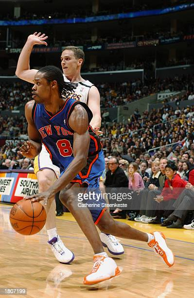 Latrell Sprewell of the New York Knicks drives past Mark Madsen of the Los Angeles Lakers during the game at Staples Center on February 16 2003 in...