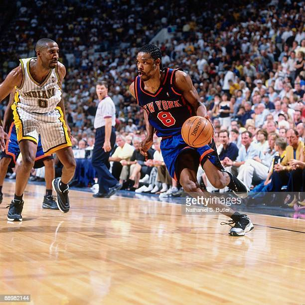 Latrell Sprewell of the New York Knicks drives the ball against Derrick McKey of the Indiana Pacers in Game One of the Eastern Conference Finals...