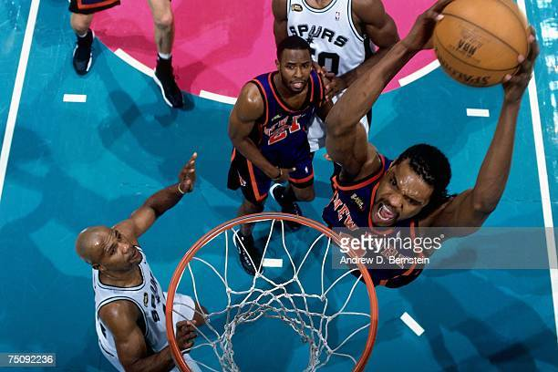 Latrell Sprewell of the New York Knicks dunks against Mario Elie of the San Antonio Spurs in Game Two of the 1999 NBA Finals played at the Alamodome...