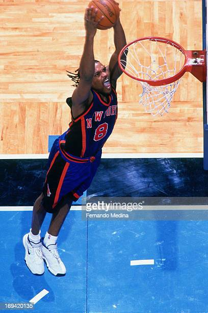 Latrell Sprewell of the New York Knicks dunks against the Orlando Magic circa 1999 at the Orlando Arena in Orlando Florida NOTE TO USER User...