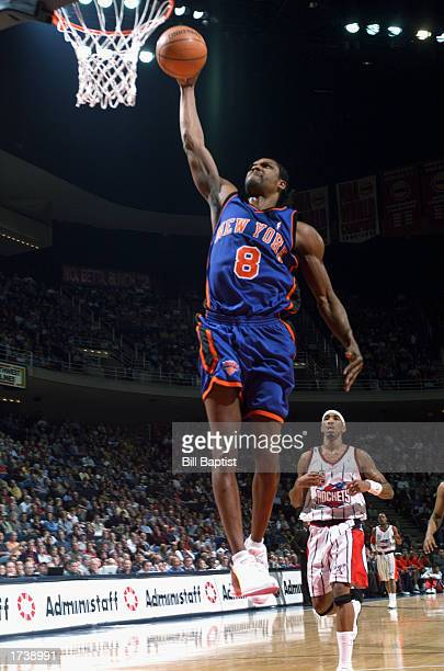 Latrell Sprewell of the New York Knicks dunks in front of Eddie Griffin of the Houston Rockets during the game at Compaq Center on December 27 2002...