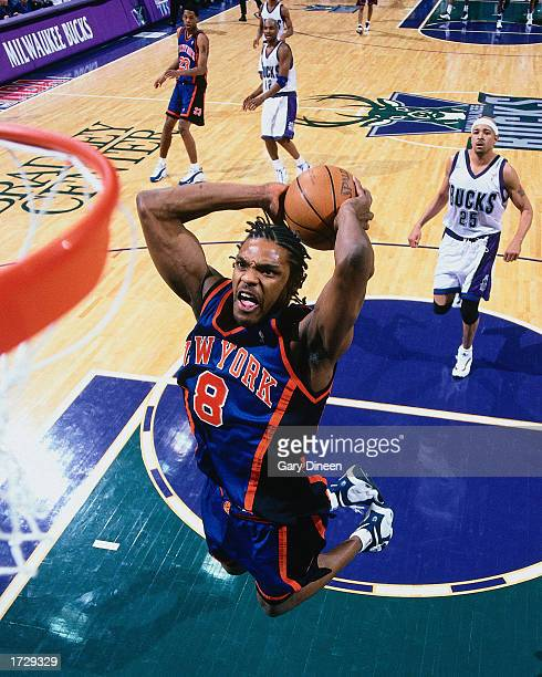 Latrell Sprewell of the New York Knicks goes for a dunk against the Milwaukee Bucks during the NBA game at the Bradley Center on January 1 1999 in...