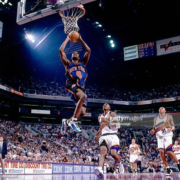 Latrell Sprewell of the New York Knicks goes for a dunk against the Phoenix Suns during the NBA game in 2000 at America West Arena in Phoenix Arizona...