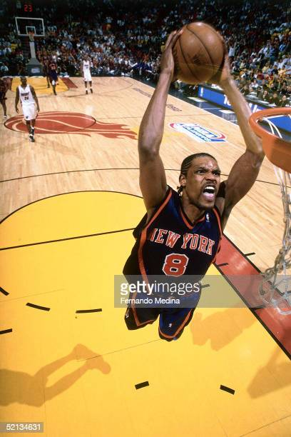 Latrell Sprewell of the New York Knicks goes for a dunk against the Miami Heat during the NBA game in 2000 at American Airlines Arena in Miami...