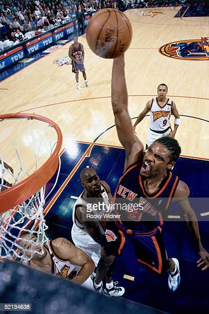Latrell Sprewell of the New York Knicks goes for a dunk against the Golden State Warriors during the NBA game in 2000 at the Arena At Oakland in...
