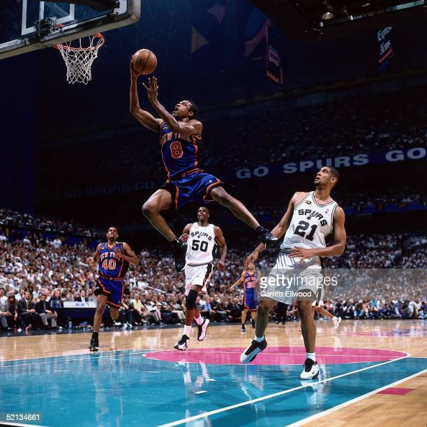 Latrell Sprewell of the New York Knicks goes for a dunk against the San Antonio Spurs during the NBA game in 1999 at the Alamo Dome in San Antonio...