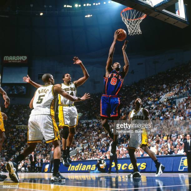 Latrell Sprewell of the New York Knicks goes for a layup against Jalen Rose Chris Dudley and Ben Davis of the Indiana Pacers in Game Two of the...
