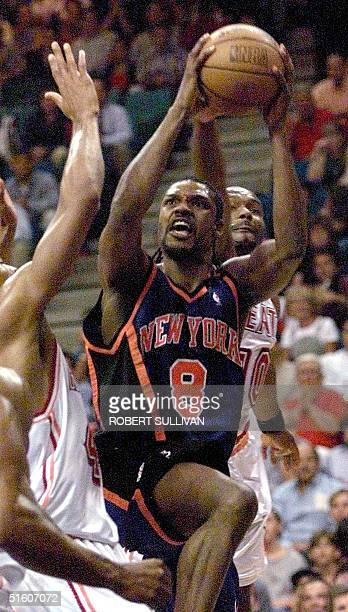 Latrell Sprewell of the New York Knicks goes to the basket against the Miami Heat in 1st quarter action 10 May 1999 during game two of their 1st...