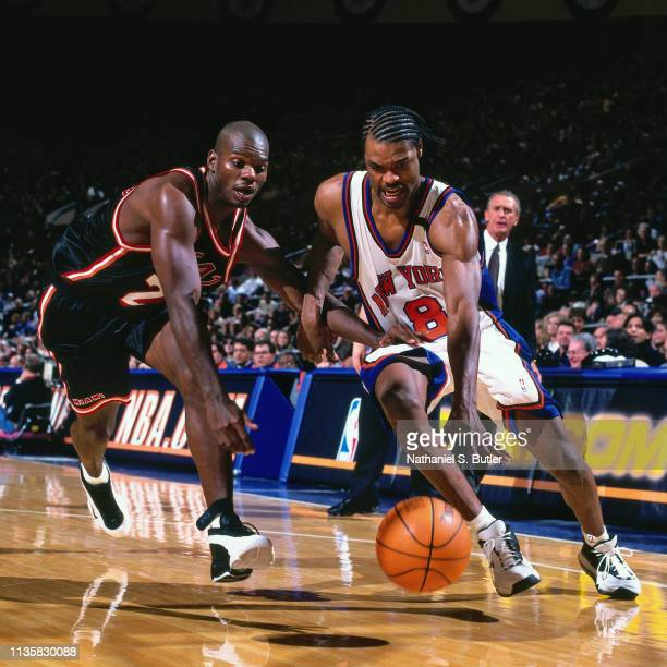 Latrell Sprewell of the New York Knicks handles the ball against the Miami Heat on February 7 1999 at the Madison Square Garden in New York New York...