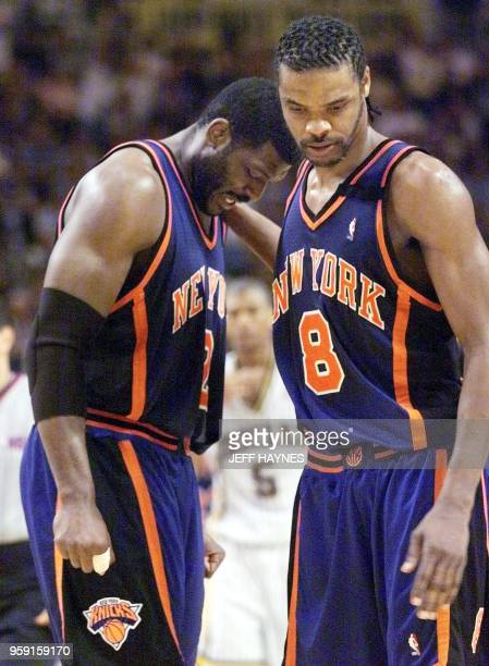 Latrell Sprewell of the New York Knicks hugs teammate Larry Johnson after Johnson fouled out 01 June 1999 in the second half of their NBA Eastern...