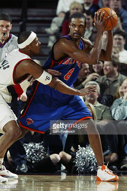 Latrell Sprewell of the New York Knicks is defended by Bonzi Wells of the Portland Trail Blazers during the game at the Rose Garden on February 17,...