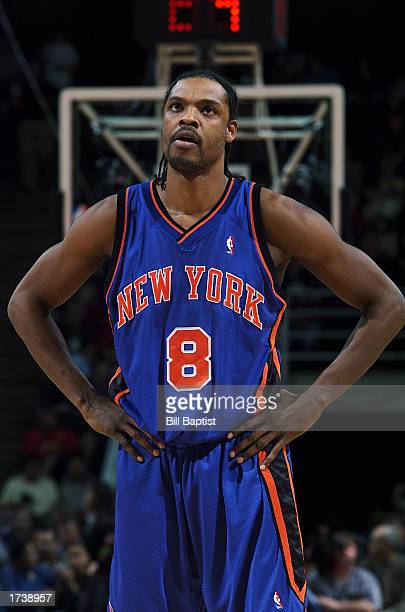 Latrell Sprewell of the New York Knicks looks on with his hands on his hips against the Houston Rockets during the game at Compaq Center on December...
