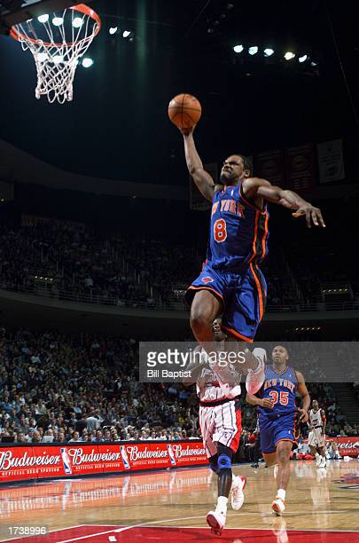 Latrell Sprewell of the New York Knicks looks to dunk in front of Glen Rice of the Houston Rockets during the game at Compaq Center on December 27...