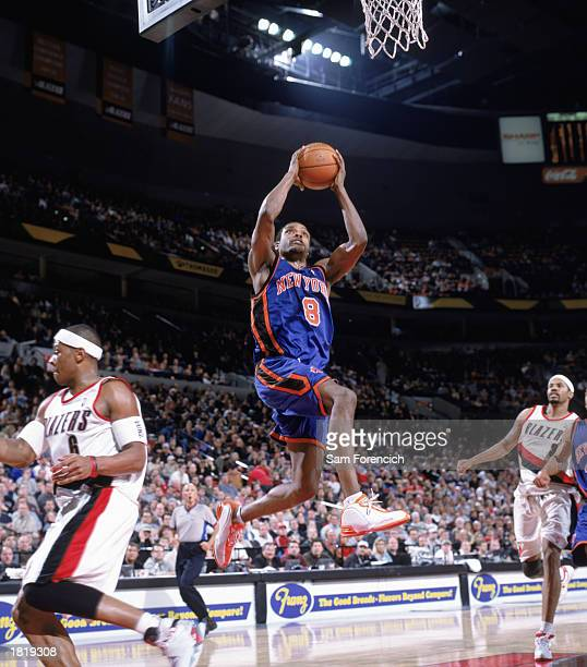Latrell Sprewell of the New York Knicks makes a layup during the NBA game against the Portland Trail Blazers at The Rose Garden on February 17 2003...
