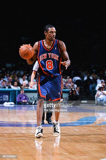 Latrell Sprewell of the New York Knicks moves the ball during the game against the Charlotte Hornets on February 7 2000 at Charlotte Coliseum in...