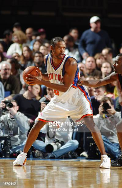 Latrell Sprewell of the New York Knicks posts up against the Philadelphia 76ers during the NBA game at Madison Square Garden on November 16 2002 in...