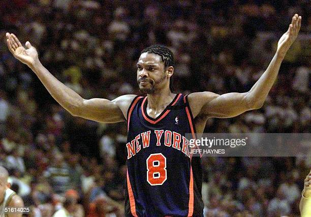 Latrell Sprewell of the New York Knicks reacts as the Indiana Pacers crowd starts chanting his name 09 June during the second half of game five of...