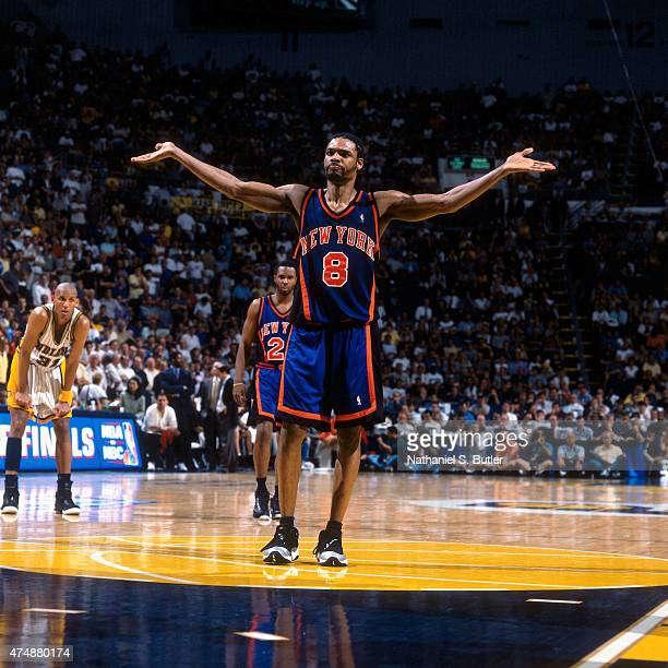 Latrell Sprewell of the New York Knicks reacts to a play against the Indiana Pacers during a game in 1999 at Market Square Arena in Indianapolis...