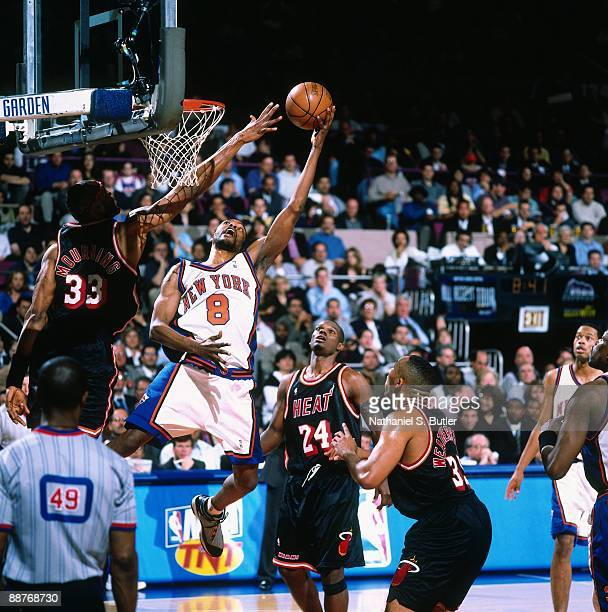Latrell Sprewell of the New York Knicks shoots a layup against Alonzo Mourning of the Miami Heat in Game Four of the Eastern Conference Quarterfinals...