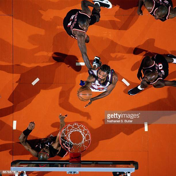 Latrell Sprewell of the New York Knicks shoots a layup against the Miami Heat in Game Four of the Eastern Conference Quarterfinals during the 1999...