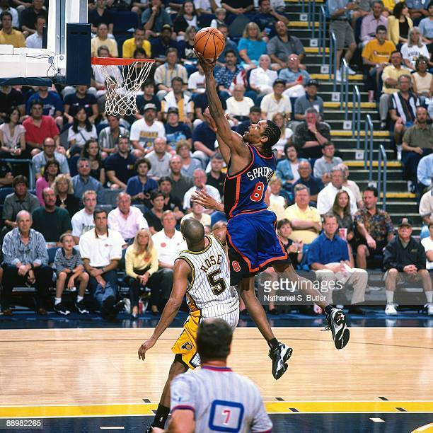 Latrell Sprewell of the New York Knicks shoots against Jalen Rose of the Indiana Pacers in Game One of the Eastern Conference Finals during the 1999...
