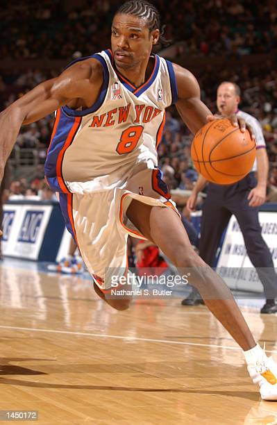 Latrell Sprewell of the New York Knicks with the drive during a game against the Memphis Grizzlies at Madison Square Garden in New York New York...