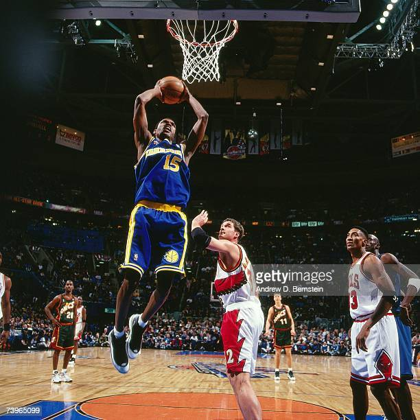 Latrell Sprewell of the Western Conference dunks against Christian Laettner of the Eastern Conference during the 1997 AllStar Game on February 9 1997...