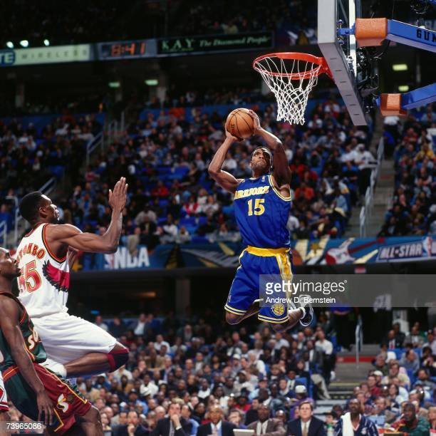 Latrell Sprewell of the Western Conference dunks against Dikembe Mutombo of the Eastern Conference during the 1997 AllStar Game on February 9 1997 at...