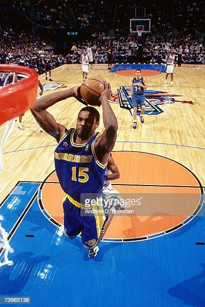 Latrell Sprewell of the Western Conference dunks during the 1997 AllStar Game on February 9 1997 at Gund Arena in Cleveland Ohio NOTE TO USER User...