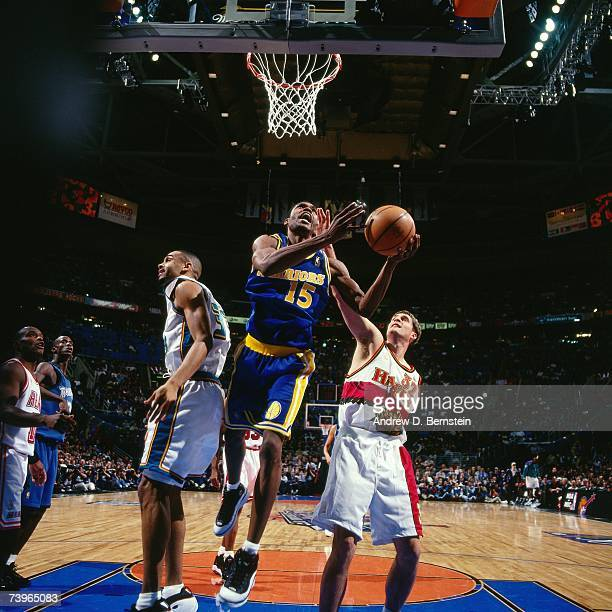 Latrell Sprewell of the Western Conference shoots against Christian Laettner of the Eastern Conference during the 1997 AllStar Game on February 9...
