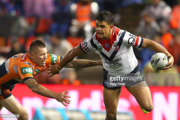 Latrelle Mitchell of the Roosters is tackled during the round 14 NRL match between the Newcastle Knights and the Sydney Roosters at McDonald Jones...