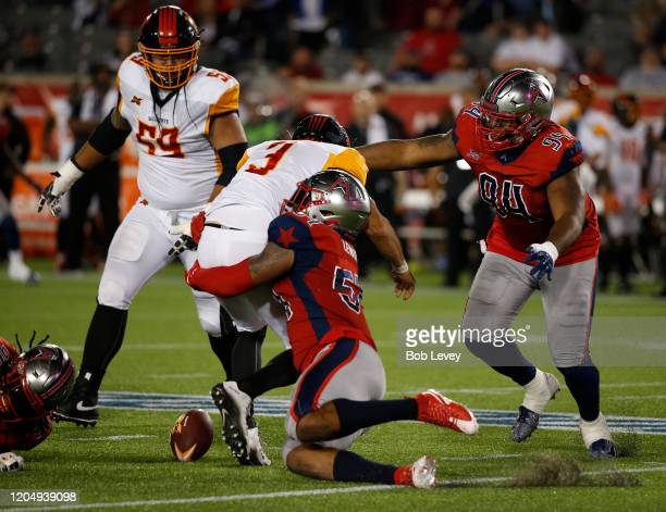 LaTroy Lewis of the Houston Roughnecks forces Chad Kanoff of the LA Wildcats to fumble the ball at TDECU Stadium on February 08, 2020 in Houston,...