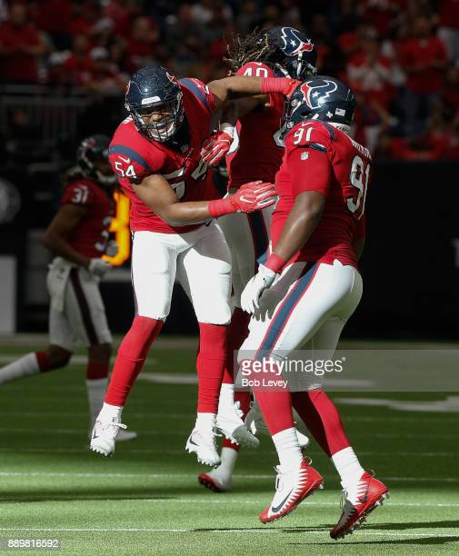LaTroy Lewis of the Houston Texans celebrates with Carlos Watkins and Marcus Williams after a defensive stop in the second half against the San...