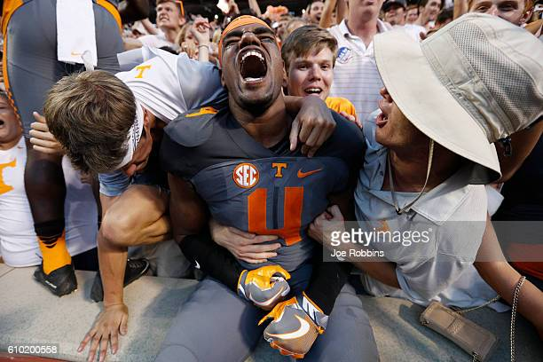 LaTroy Lewis of the Tennessee Volunteers celebrates with fans after the Vols defeated the Florida Gators 38-28 at Neyland Stadium on September 24,...