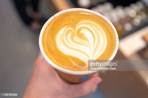 Latte art atop an oatmilk latte at newly opened Blue Bottle Coffee cafe at the Santana Row shopping mall in the Silicon Valley San Jose California...