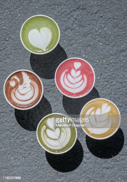 latte art - turmeric, beetroot, matcha, hot chocolate as alternative to coffees - latte stock pictures, royalty-free photos & images