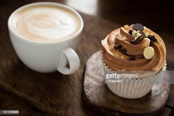 Latte coffee and a triple chocolate cupcake