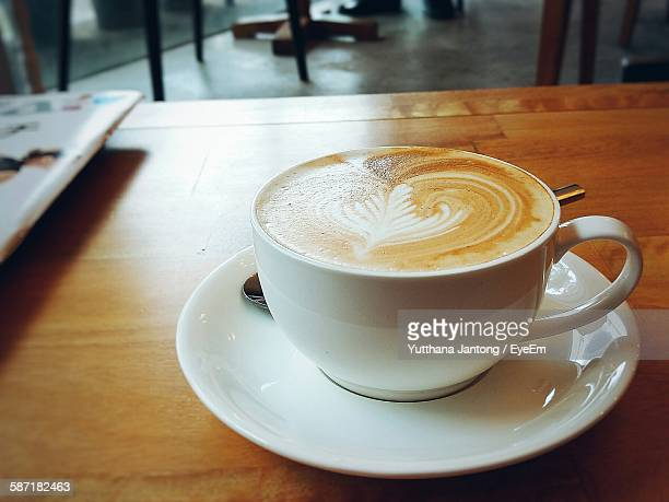 Latte In Coffee Cup On Table