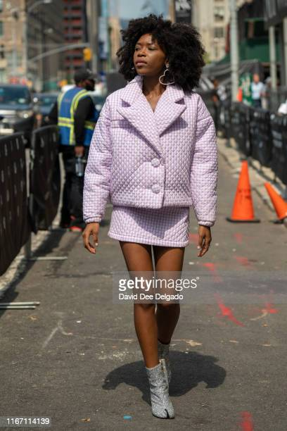 Latte Samuels is seen wearing a quilted lavender gingham jacket and matching mini-skirt with glitter boots during New York Fashion Week at Spring...