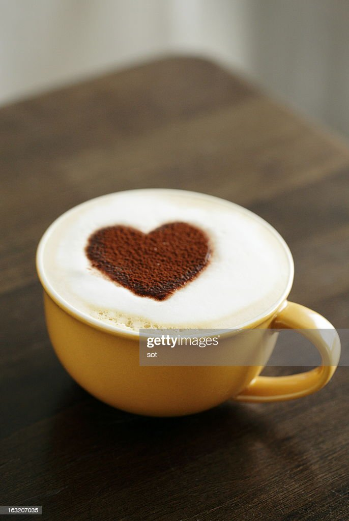 Latte with heart-shaped foam : Stock Photo