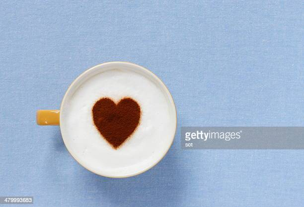 Latte with heart-shaped foam,aerial view