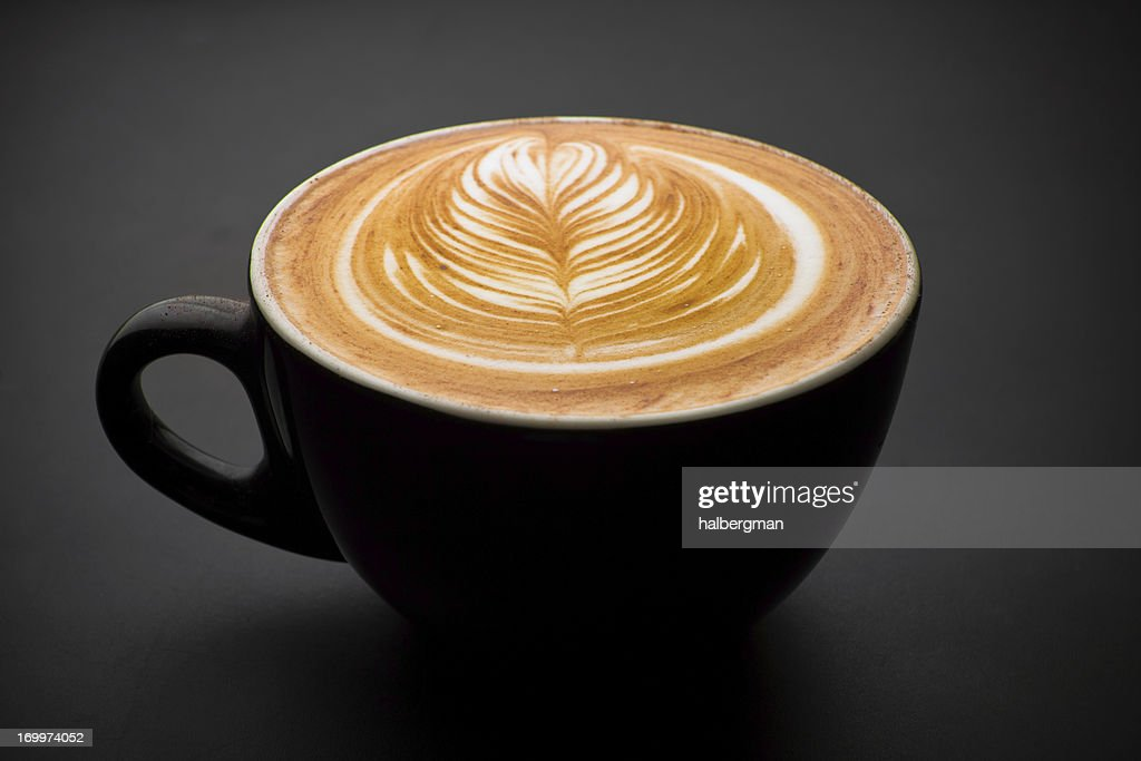 Latte with intricate foam art : Stock Photo